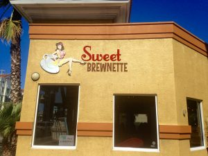 Logo design using a women and a coffee cup business called Sweet Brewnette