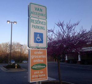 Handicapped parking space with order groceries online promotion