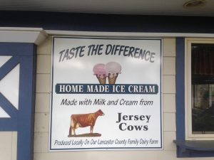 Sign promoting their brand of a homemade from a local family dairy farm