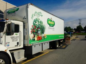 Image of delivery truck with company name and tagline to promote their brand