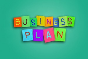 The words Business Plan written on sticky colored paper